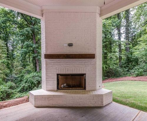 Carolyn -Covered Patio Brick FIreplace